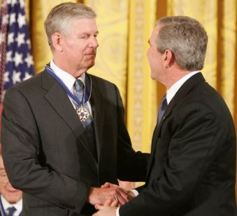 President George W. Bush shakes the hand of General Richard Myers, retired Commander of the Joint Chiefs of Staff, after presenting him with the Presidential Medal of Freedom during ceremonies November 9, 2005, at the White House. White House photo by Paul Morse.