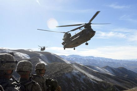 U.S. Soldiers with the 101st Division Special Troops Battalion, 101st Airborne Division watch as two Chinook helicopters fly in to take them back to Bagram Airfield, Afghanistan, November 4, 2008.